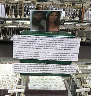 A donation box for the Benitez family sits on the counter at Joyeria Latina Americana, a jewelry store on Milpas Street.