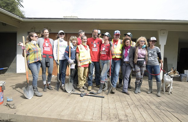 Jack and Kim Johnson pose for a photo with Bucket Brigade volunteers in Montecito. (March 17, 2018)