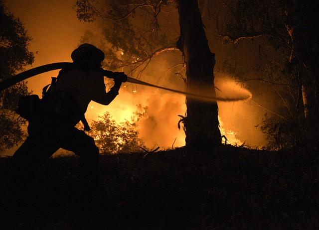 Firefighters battle the Holiday Fire on La Goleta Road. (July 6, 2018)
