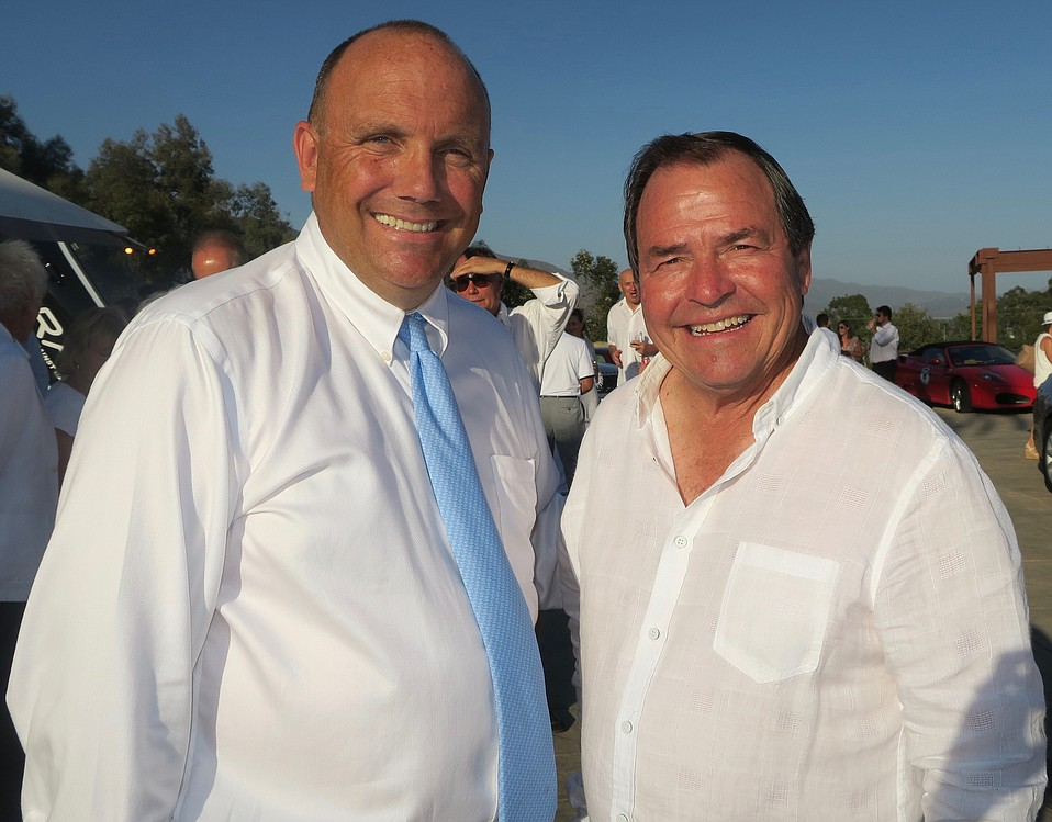 CEO Michael Baker and Board President Eloy Ortega.