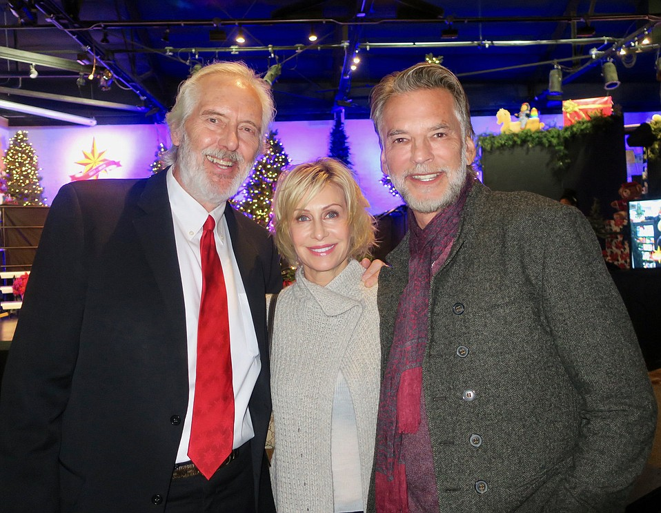 Unity Shoppe Executive Director Tom Reed, Lisa Hawkins, and Kenny Loggins