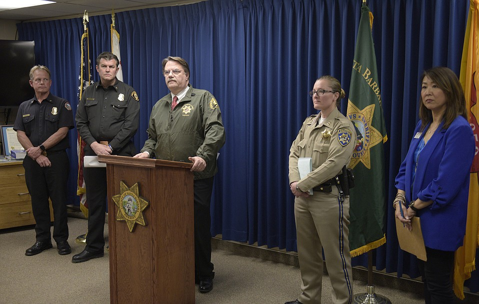 Santa Barbara County Sheriff Bill Brown (center) announces mandatory evacuations of the Thomas/Whittier/Sherpa fire burn areas, starting 4 p.m. on Tuesday, March 5, due to a strong storm arriving.