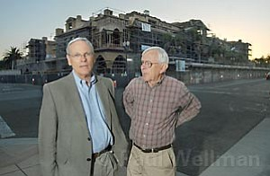 Bendy White (left) and Bill Mahan with the 60 foot tall Chapala One building in the background