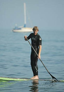 Dude, was that a shark? Author Ethan Stewart learns to leave prejudice on the shore and finds hypocritical deliverance on a stand-up paddle board.