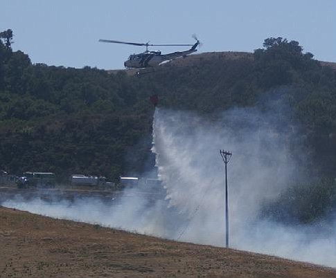 A helicopter battles a brush fire on Nojoqui Grade on Wednesday, May 23, 2007.