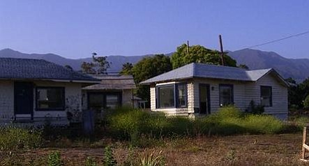 The Miramar as it is today, blue, white, and dilapidated.