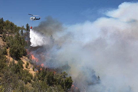 Helicopters work nonstop to keep the fire from escaping the Manzana drainage, making it possible to hold this section of the ridge.