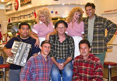 The pump boys and the dinettes are, from left:  Joseph Beck (L.M.), Tiffany Story (Rhetta Cupp), Alan Kirk (Eddie), Susie Couch (Prudie Cupp), and Jason Bray (Jackson). In front, on the left, Brain Harwell (Bernie), and on the right, Sam Warren Spade (Jim).