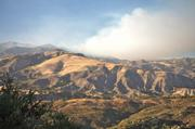 Looking at the fire burning in Santa Cruz Canyon from the observation point on Highay 154.