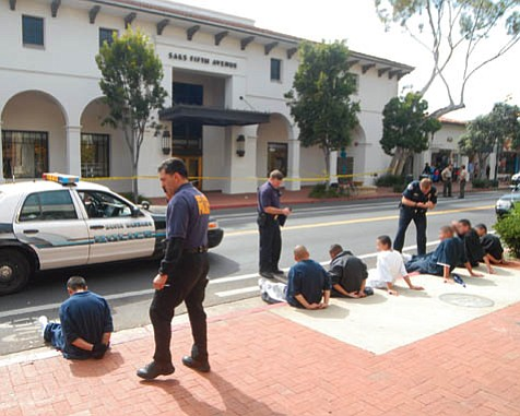 Suspected gang members involved in the stabbing murder of Angel Linares are detained on State Street in March 2007.