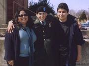 Jaime with his older sister, Elizabeth (left), and younger brother, Alex (right), at his graduation from basic training