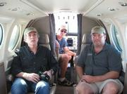 The expedition team aboard the plane