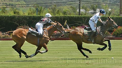 Gonzalito Pieres of Audi Polo (left) defends against Jeff Blake of Grant's Farm/ERG in Audi's 12-11 victory.