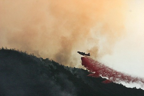 Air attack drops retardant on the upper ridge above the slopover to keep it from moving uphill towards Cuyama Peak.
