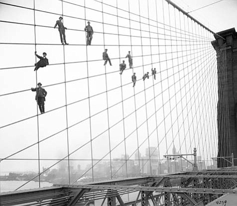Painters on the cables of the Brooklyn Bridge, October 7, 1914.Photograph by Eugene deSalignac.