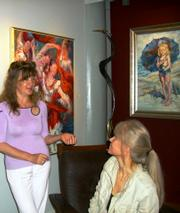 "The artist, Virga (left), and, ""The Dish,"" Martha Smilgis at an opening."