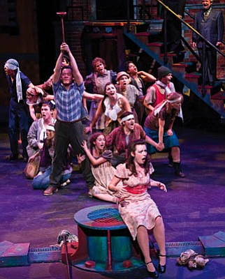 Oppression and rebellion take center stage in <em>Urinetown</em>, where daughter-in-distress Hope Caldwell (played by Vanessa Ballam, front) must choose between the pee-freedom-fighting hero Bobby Strong (played by Sung Min Park, with plunger) and her father, the evil one who charges everyone to pee.