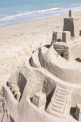 Location, location, location:  Considering the prime beach-front real estate this sandcastle occupies, it would be worth a fortune if it were inhabitable by creatures other than sand crabs.