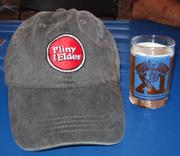 A glass of Russian River Brewing's Pliny the Elder-one of the best double IPAs in the country-sits next to its namesake hat.