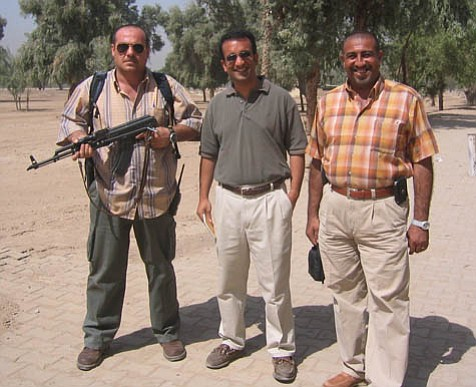 <em>Washington Post</em> reporter Rajiv Chandrasekaran (center) spent much of 2003 and 2004 in Baghdad, passing freely in and out of the U.S.-occupied Green Zone.