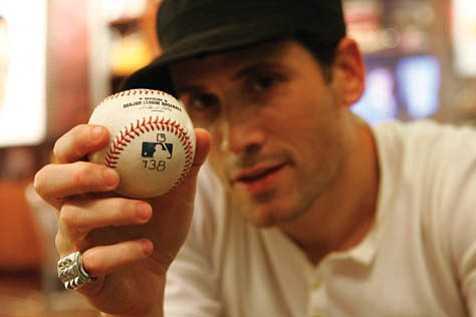 Fashion designer Marc Ecko holds the Barry Bonds record-breaking homerun baseball, which a Goleta-based company might brand with the asterisk voted on by about 4.7 million people.