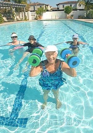 Work it out! From left: Barbara Schonfeld, Jeannie Christensen, Anne Rein, and Judi Biegen enjoy fun under the sun at Maravilla Senior Living.