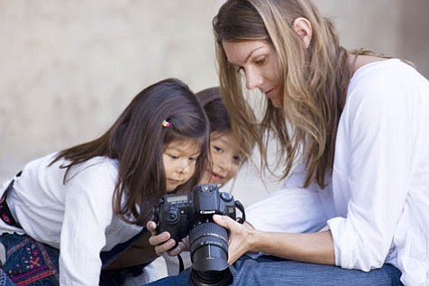 Photographer Christy Schuler shares her digital photographs with two young girls  in foster care.