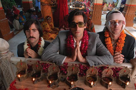 From left: Jason Schwartzman, Adrien Brody, and Owen Wilson play three brothers on a quest aboard The Darjeeling Limited in a world of director Wes Anderson's making.