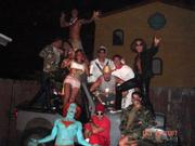 A group of partiers pose in their front yard on Del Playa Drive