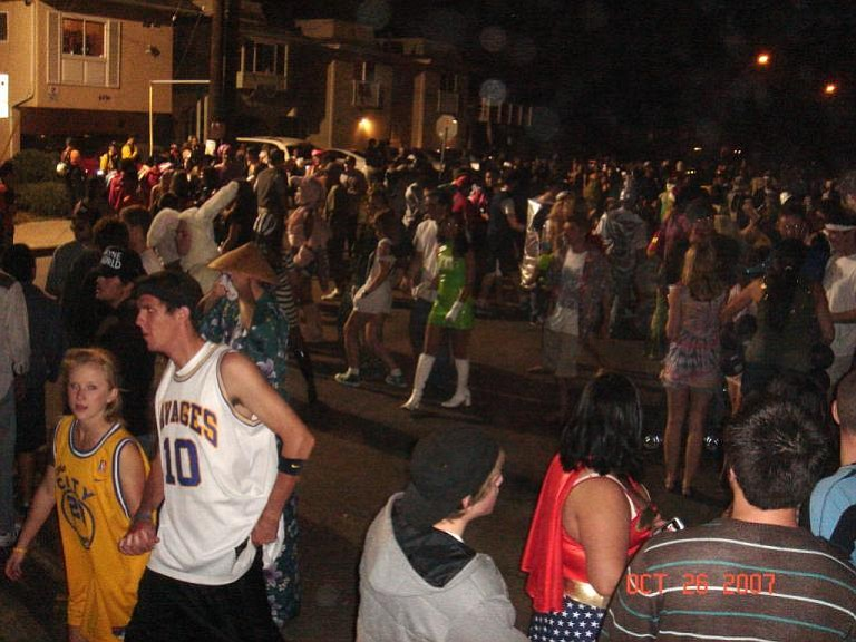 A throng of Halloween revelers at party central--the corner of Del Playa and Camino Pescadero.