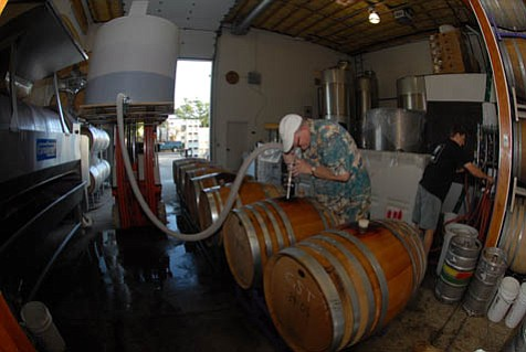 Potency at the Pumps: Jaffurs wine ambassador Larry Archibald (above) fills up a French oak barrel with what will be the winery's 2007 grenache.