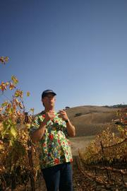 Peter Work, owner of Ampelos Cellars, leads a tour of his vineyard just minutes before spotting the nearby blaze.