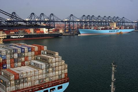 Shipping containers come to port.