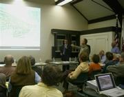 Concerned Montecitans watched as Rick Caruso and his planner presented plans for the new Miramar.