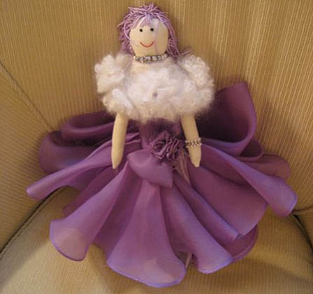 Alyce Faye Cleese created this doll for the Girls Inc. benefit.
