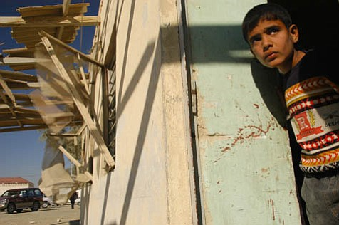 Among the images included in Ashley Gilbertson's book is this one of a young boy standing in the blood-covered threshold of a house belonging to the head of Ramadi's governing council after insurgents' attacks postponed the American military's plans to pull out of Ramadi.