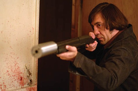 Bringing out the big guns: Javier Bardem is a menacing killer in the Coen brothers' latest, <em>No Country for Old Men.</em>