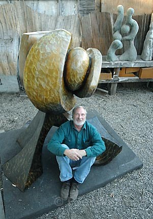 """Sculptor Larry Rankin at his Santa Barbara studio with one of his works, """"Sedona Sunset."""""""