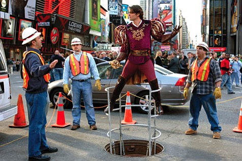 Prince Edward (James Marsden, right) emerges from the portal (a Times Square manhole) connecting the animated and live-action worlds of <em>Enchanted</em>.