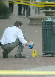Crime scene investigator Mike Ullemeyer with evidence