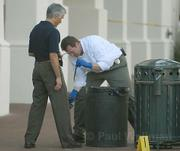 Detectives discover a knife in the trash can.