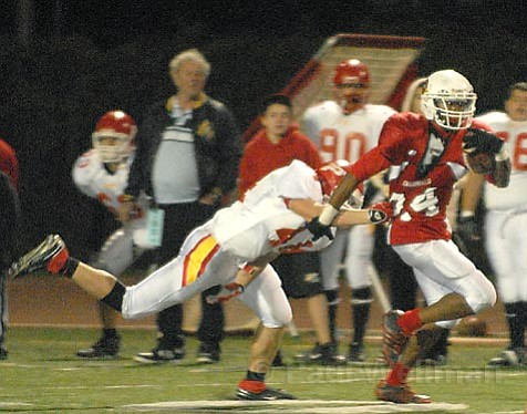 Bishop Diego senior Eli Orosco goes for a touchdown against Paraclete in the division semifinals. The Cardinals went on to win 12-6, earning their game on Saturday night against Santa Clara.