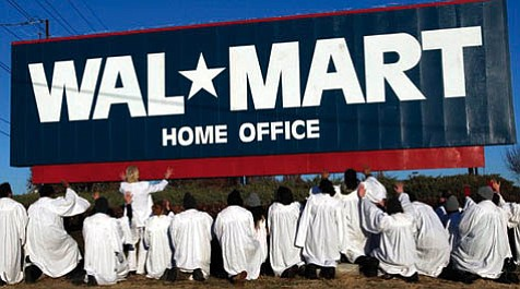 "Reverend Billy and the Stop Shopping Gospel Choir attempt an ""exorcism"" at Wal-Mart corporate headquarters in the documentary <em>What Would Jesus Buy?</em>"