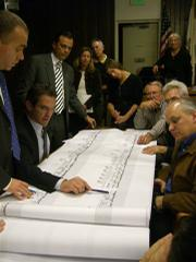 Rick Caruso stands back as his cohorts Matt Middlebrook and Michael McManus unveil the new Miramar plans.