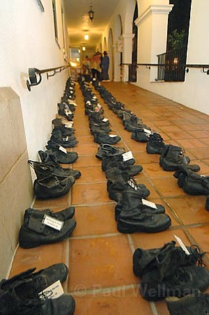 Four-hundred-sixteen pairs of army boots were laid out in front of City Hall to commemorate the number of California servicemen and women killed in Iraq.
