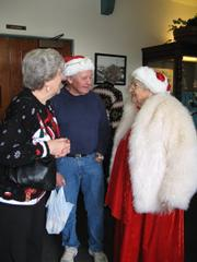 Mrs. Claus, aka Connie Steketee, spreads cheer at the GVCC party.