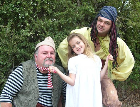 Pirates Steve Jones and Miller James flank Tessa Miller, one of the singing and dancing children from SBT's <em>Magical Musical Tour</em>.