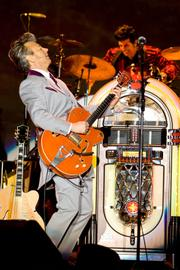 Former Stray Cat Brian Setzer led his orchestra through a night of classic hits and rollicking Christmas tunes last Friday at the Chumash Casino.