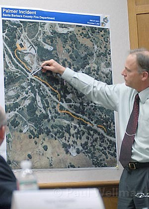 A Santa Barbara County Fire representative demonstrates the recent incident at Greka's Palmer Road plant.
