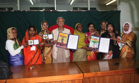 Nobel Peace Prize recipient Professor Muhammad Yunuspictured center, with members of the Grameen Bank board, at the Nobel Prize ceremonies in Norway in December 2006Â-.